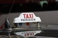 MPs are considering taking away Paris taxi drivers' monopoly at Charles de Gaulle airport