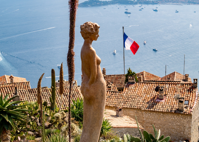 A French flag flies in the Eze botanical garden, Èze, France