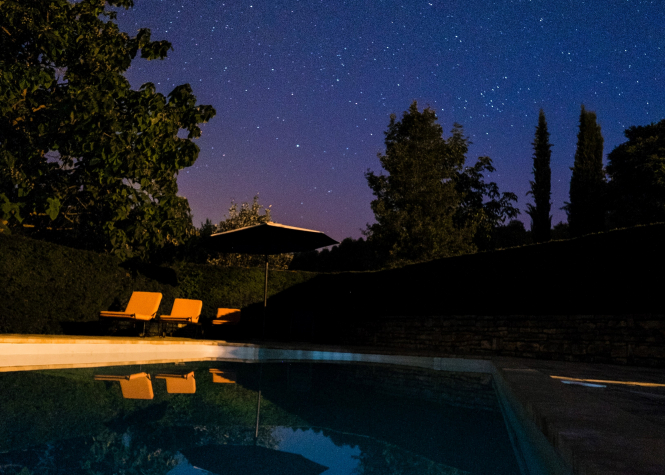 A pool at night, in Nantoux, France. Fabrice Villard / Unsplash