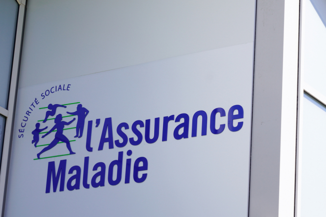 An Assurance maladie sign on the side of a building as part of a guide to healthcare in France 2021
