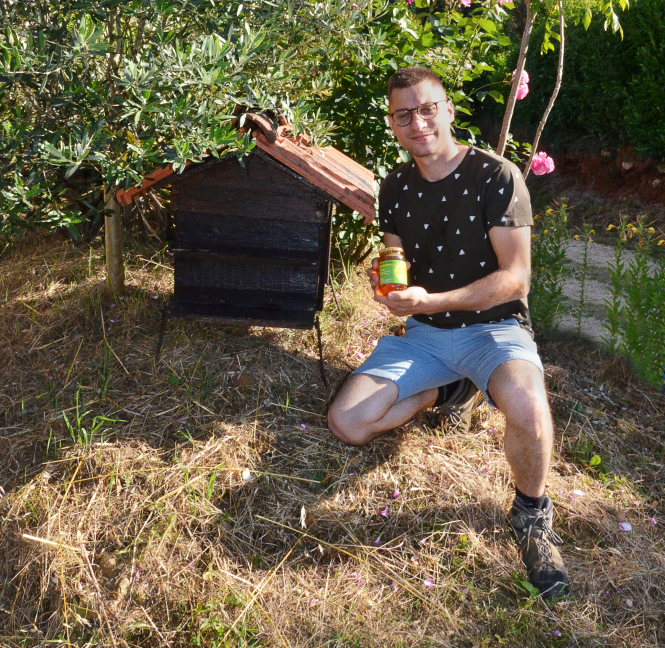 Benoit Serre next to his great-grandfather's original hive.