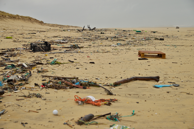 Bits of plastic and other materials lay littered across a beach in Cap Ferret, Lège-Cap-Ferret, France.