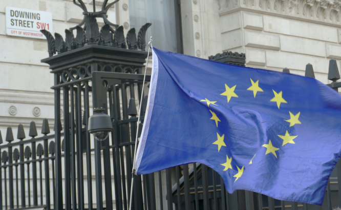 Brexit talks and EHIC cards. European flag at Downing Street.
