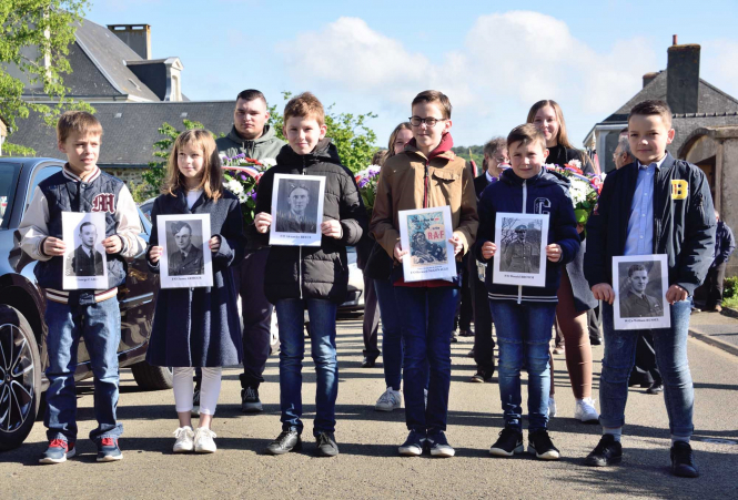 Village Children leading procession with pictures of William MacFarlane Russell and his crew of Halifax