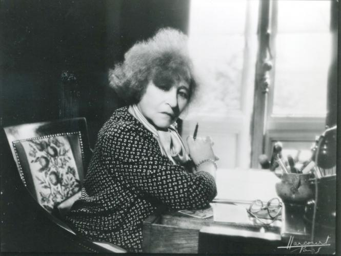 Colette at her desk