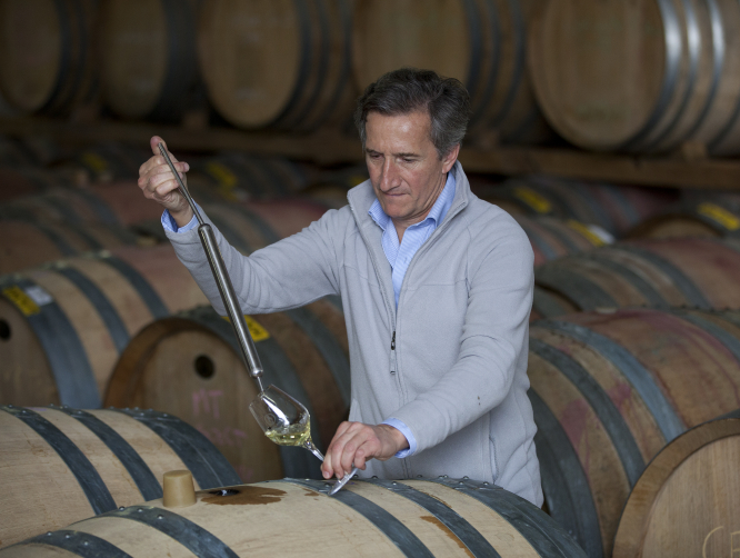 Jacques Lurton, owner of Islander Estate Vineyards in Australia, with barrels of wine. Connexion print edition.