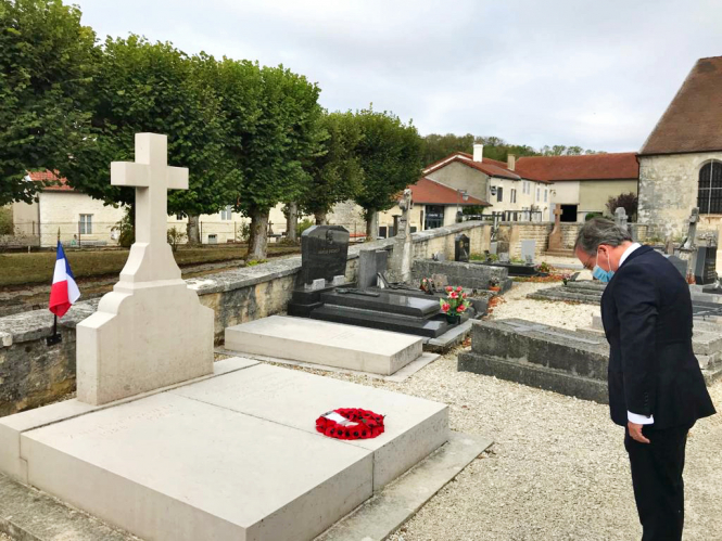 Leaving a wreath at General de Gaulle's grave. Connexion October print edition