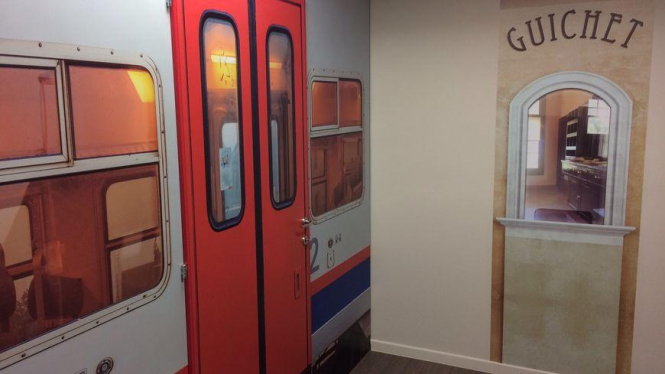 Interior of mock railway ticket office and train