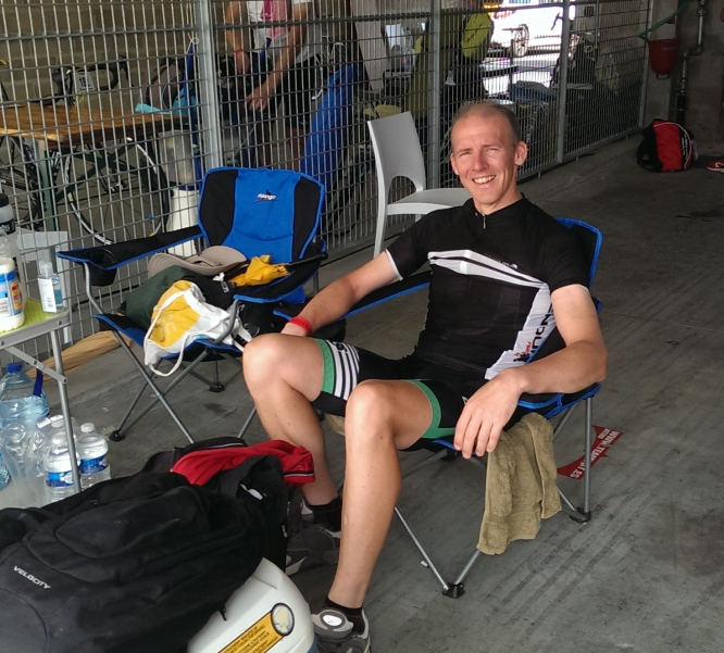 Man sits back in chair after strenuous cycle ride