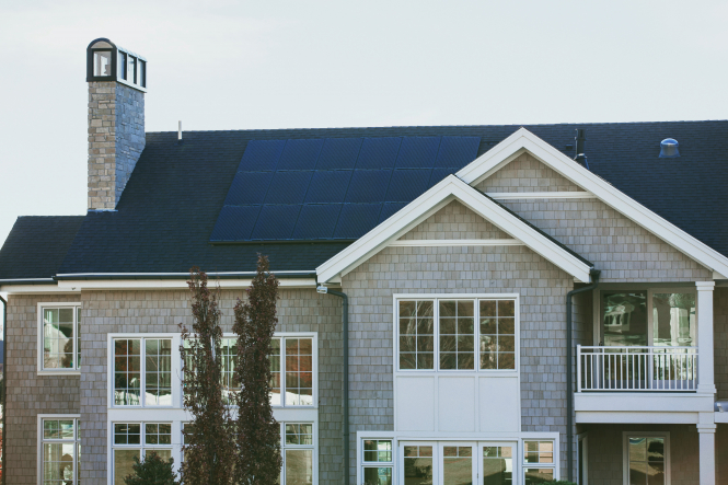 Pictured: a house with solar panels installed on the roof.