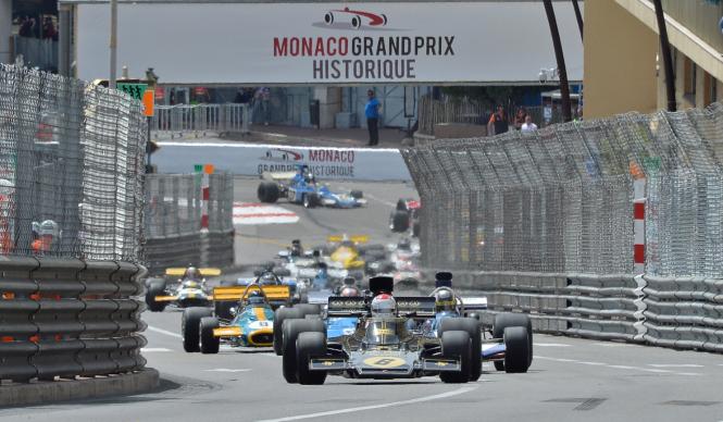 Vintage F1 cars racing around the Monaco Grand Prix course