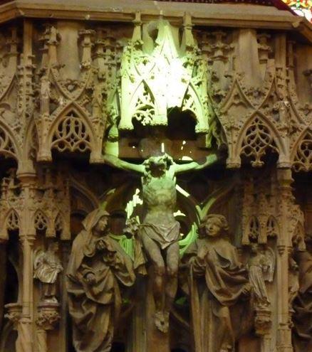 Green light shines on statue of Christ