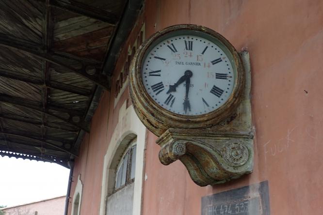 The platform clock at the old railway station at Gabian.