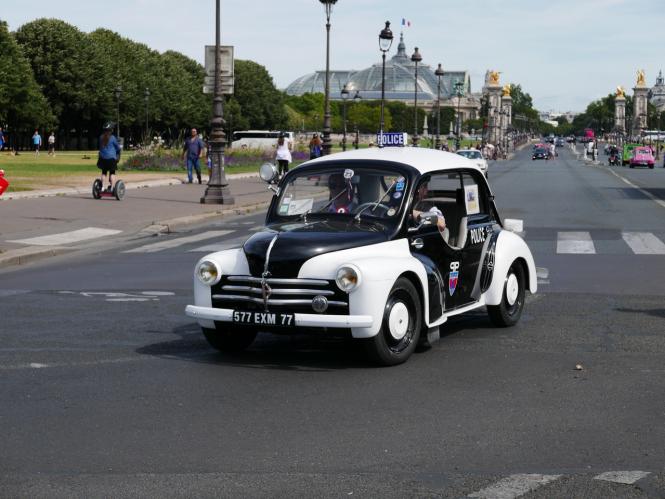 vintage police car on the streets of Paris during a Traversee de Paris vintage car event