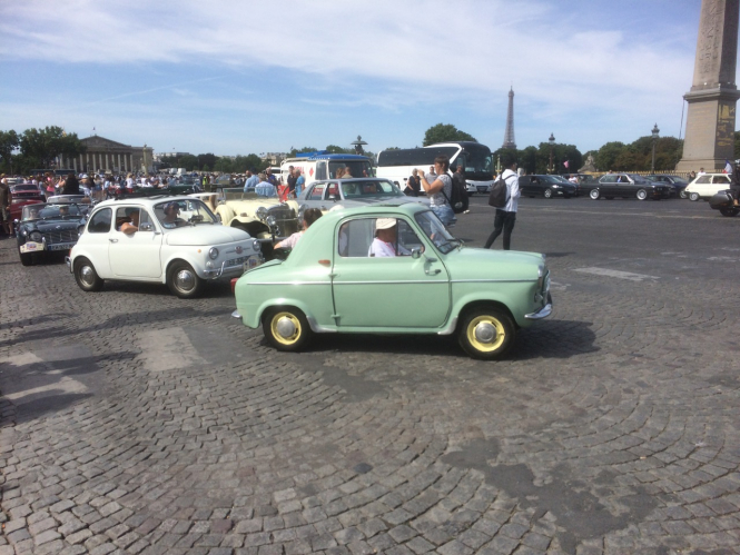 vintage vehicles on the streets of Paris as part of the Traversee de Paris event