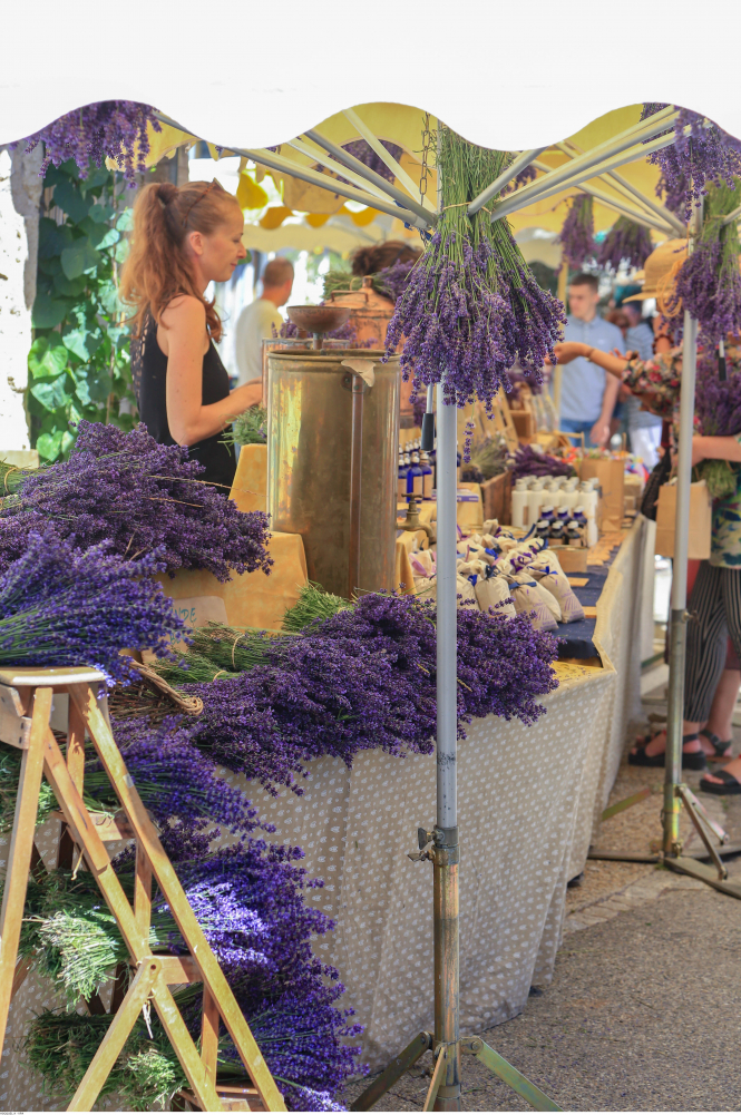 Traders show off their lavender wares at the market in Sault