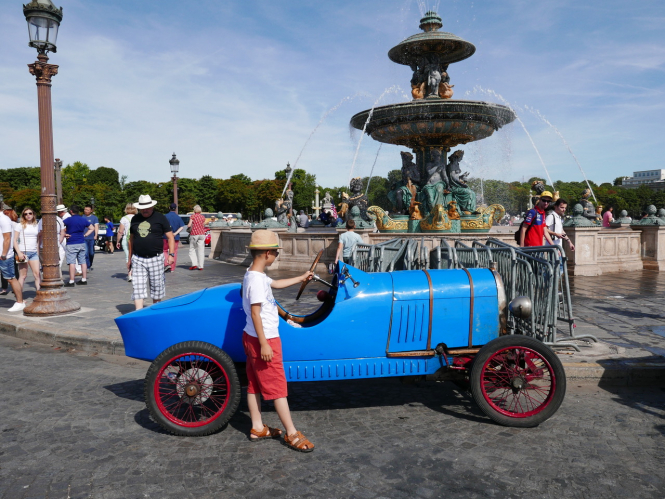 A vintage car on the streets of Paris as part of the Traversée de Paris event