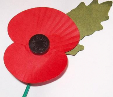 Paper red poppy with green leaf