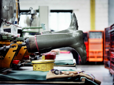 Rubber boots being manufactured at the Aigle International factory in Vienne, France