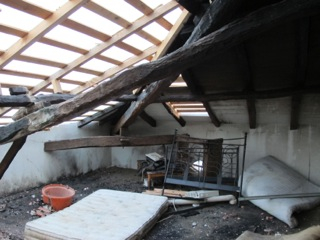 Roof beams and room in burned out house