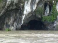 The entrance to the grotto at Lourdes under water