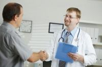 A doctor greets a patient