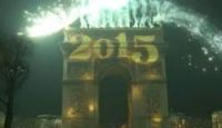The Arc de Triomphe illuminated by fireworks at midnight on New Year's Eve