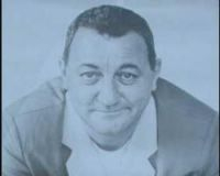 The photographer behind the iconic portrait of comedian and Restos du Coeur founder Coluche settles