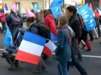 Many people waved blue or pink banners representing 'traditional' gender roles