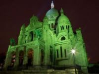 The Sacré-Coeur is being lit up green