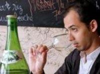 Youlin Ly noses Japanese sake - Photo: AFP PHOTO-FRANCOIS GUILLOT