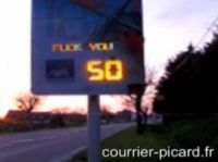 The sign snapped in action by Courrier Picard newspaper