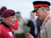 Jock Hutton and Prince Charles after the jump outside Ranville – Photo: Leon Neal/Pool/AFP