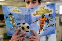 A young man reads the graphic novel telling the story of Didier Drogba's life
