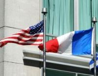 American and French flags flying together