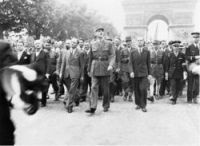 General de Gaulle and his entourage set off from the Arc de Triomphe down the Champs Elysees