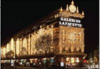 Sunday opening for famous Paris shopping streets is vital to boost tourism, the government says.