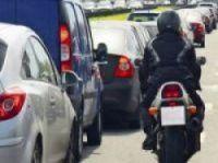 Bikers sometimes take risks in heavy traffic