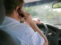 Phoning while driving is to attract a steeper fine
