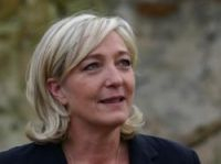 Front National leader says she will sue those referring to the party as 'extreme right'