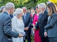Gerrad Barron (right) meets the Queen with the ambassador, left