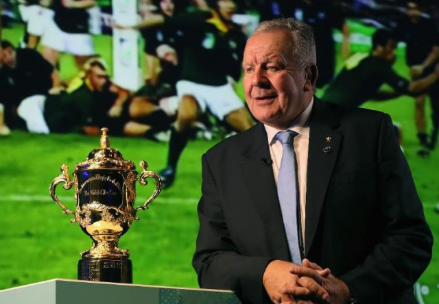 Rugby game with Bill Beaumont and Rugby World Cup in foreground