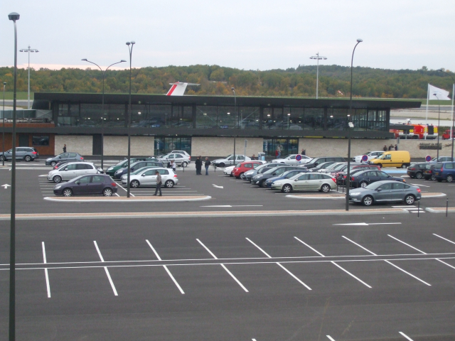 Cars in almost empty car park at airport