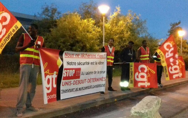 Protesting CGT Transports workers with flags and banners in France