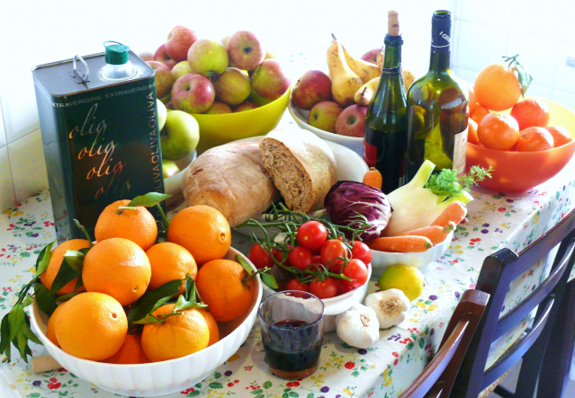 Table of fruits, bread, wine and olive oil