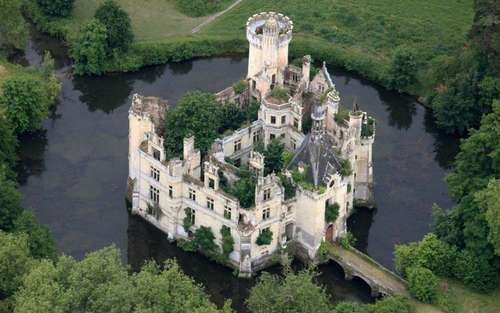 Fairytale chateau surrounded by moat, taken from air