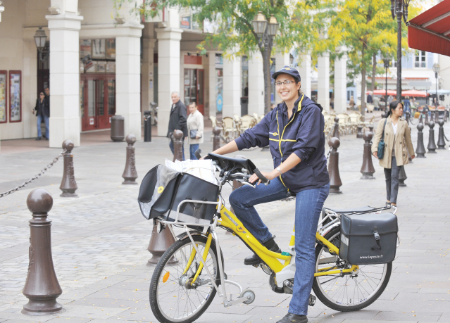 La Poste Post lady on her electric bike