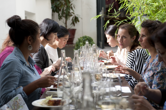 Group of diners at long table, all women