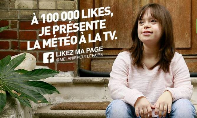 Woman with Down's syndrome sits on steps in front of door with a sign saying that she will present weather on TV if she gets 100,000 likes
