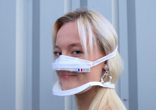 A woman wearing a masque inclusif. New laws and changes in France that impact residents and second homeowners for January 2021.jpg